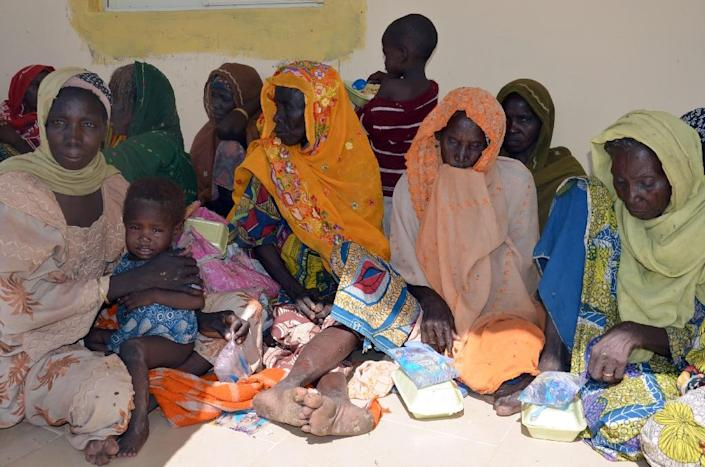 Women and children sit at the army headquaters after being rescued from Boko Haram camps in Maiduguri, Borno State, in northeastern Nigeria, on July 30, 2015 (AFP Photo/)