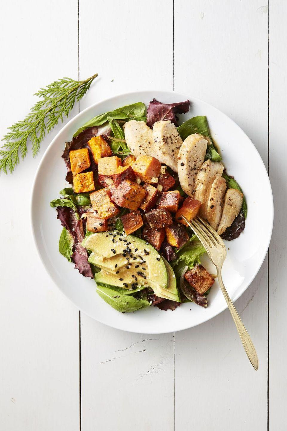 """<p>Lighten up dinner time with a nutrient-packed salad, topped with caramelized roasted sweet potatoes and time-saving rotisserie chicken.</p><p><em><a href=""""https://www.goodhousekeeping.com/food-recipes/easy/a42180/roasted-sweet-potato-and-chicken-salad-recipe/"""" rel=""""nofollow noopener"""" target=""""_blank"""" data-ylk=""""slk:Get the recipe for Roasted Sweet Potato and Chicken Salad »"""" class=""""link rapid-noclick-resp"""">Get the recipe for Roasted Sweet Potato and Chicken Salad »</a></em></p>"""