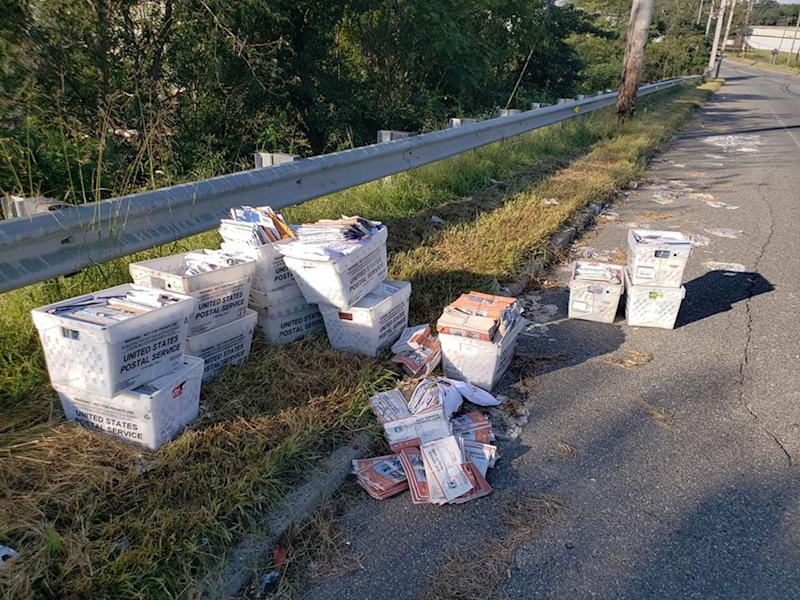Postal worker quits, boxes of mail found dumped on side of road