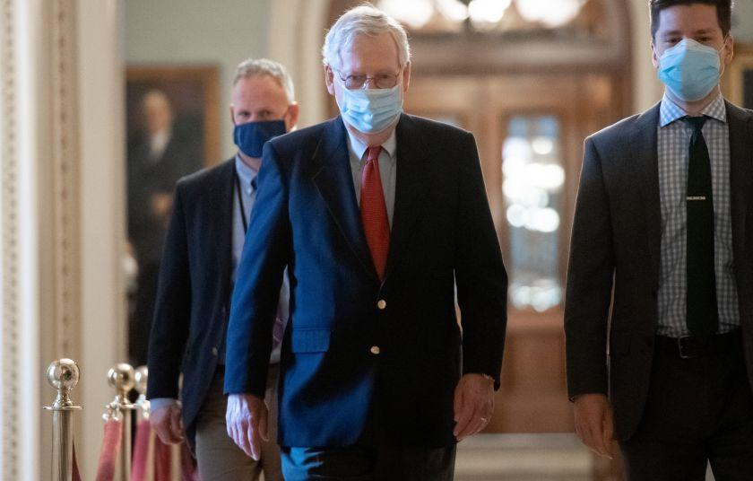 US Senate Majority Leader Mitch McConnell, Republican of Kentucky, walks to his office from the Senate Floor at the US Capitol in Washington, DC on December 18, 2020. - As lawmakers inched closer to a new stimulus package to help the pandemic-battered US economy, government data showed more workers were applying for unemployment benefits as the recovery stalled. (Photo by SAUL LOEB / AFP) (Photo by SAUL LOEB/AFP via Getty Images)