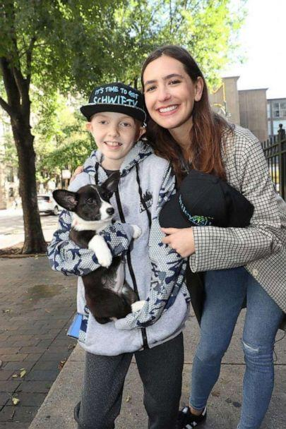 PHOTO: Johnny received his corgi puppy from Little Wish Foundation, whose founder Liz Niemiec is pictured above to Johnny's right. (Courtesy Jan Terry, Lurie Children's Hospital)