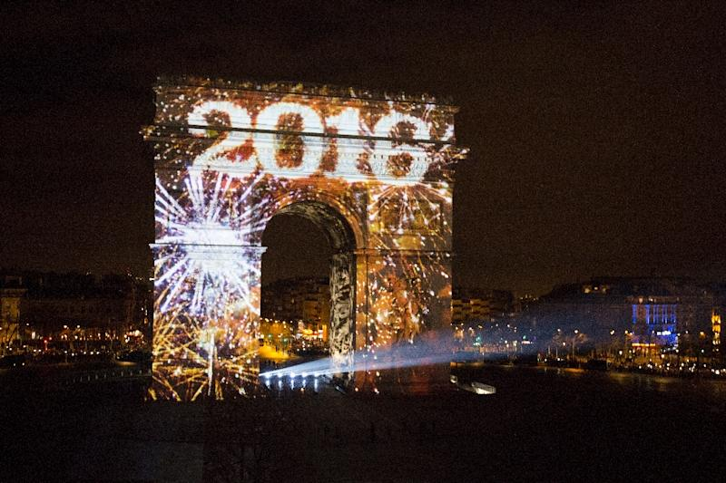 Art work is projected on Arc de Triomphe for New Year's celebrations on the Champs-Elysees avenue in Paris on January 1, 2016 (AFP Photo/Florian David)
