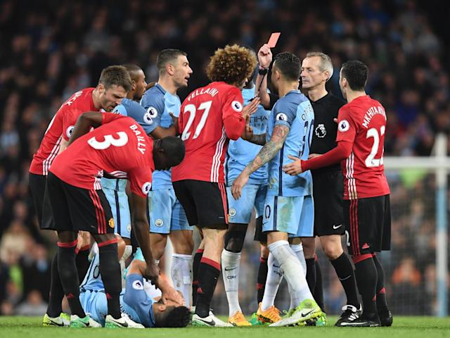 Fellaini was shown a straight red card seconds after picking up a yellow card: Getty