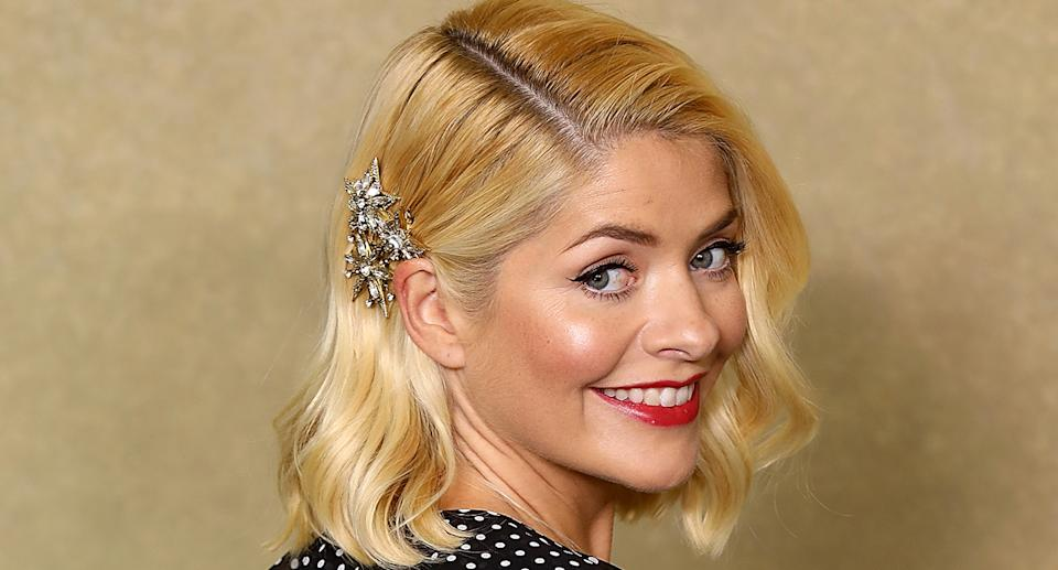Holly Willoughby's sell-out dress and checked coat are in the M&S sale. (Getty Images)