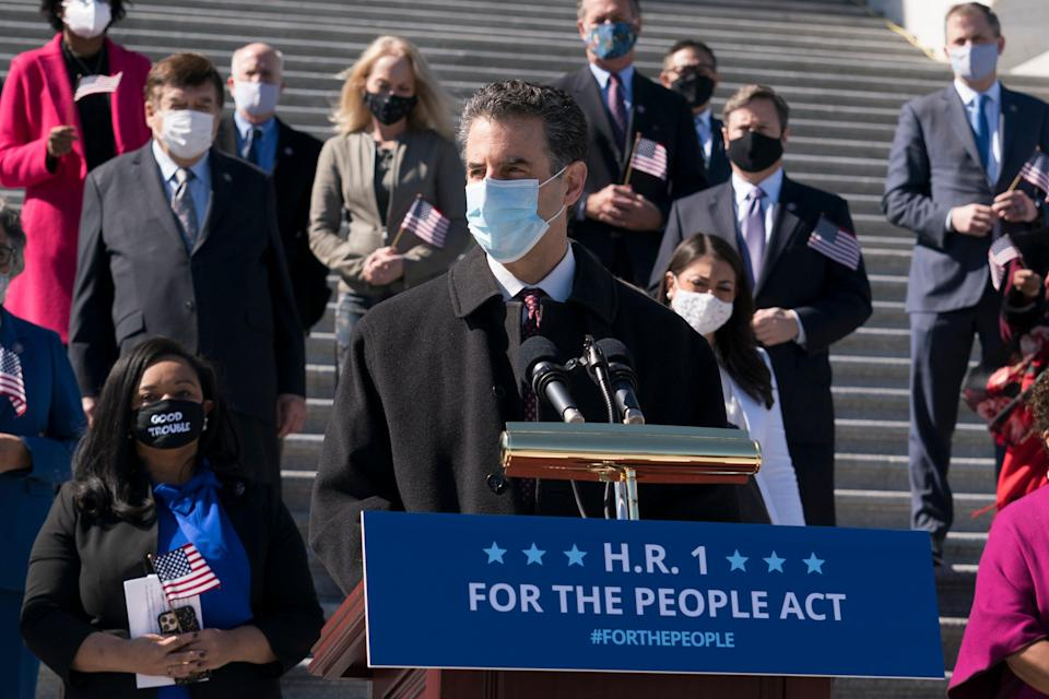 HR 1 sponsor John Sarbanes speaks with lawmakers ahead of a vote on the bill on 3 March.AP