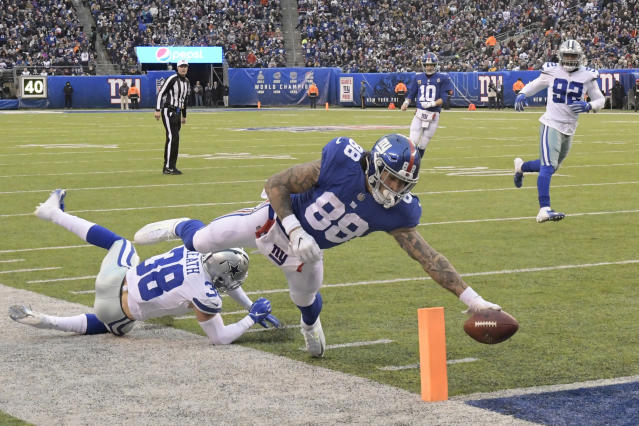 New York Giants' Evan Engram, right, scores a touchdown during the second half of an NFL football game against the Dallas Cowboys, Sunday, Dec. 30, 2018, in East Rutherford, N.J. (AP Photo/Bill Kostroun)
