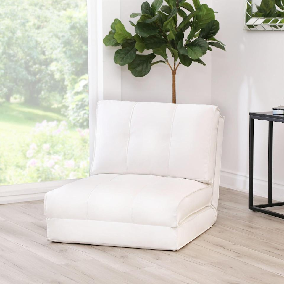 <p>This cozy <span>Kira Wide Tufted Convertible Chair</span> ($280, originally $1,910) folds out into a bed.</p>