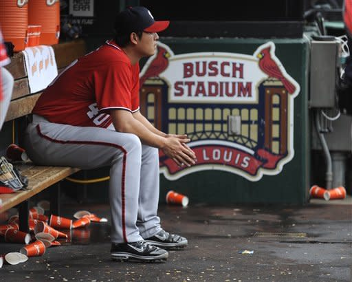 Washington Nationals pitcher Chien-Ming Wang, of Taiwan, sits in the dugout after being pulled out of a baseball game during the fifth inning against the St. Louis Cardinals Sunday, Sept. 30, 2012, in St. Louis. (AP Photo/Bill Boyce)