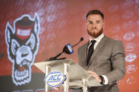 North Carolina State quarterback Devin Leary answers a question during an NCAA college football news conference at the Atlantic Coast Conference media days in Charlotte, N.C., Thursday, July 22, 2021. (AP Photo/Nell Redmond)