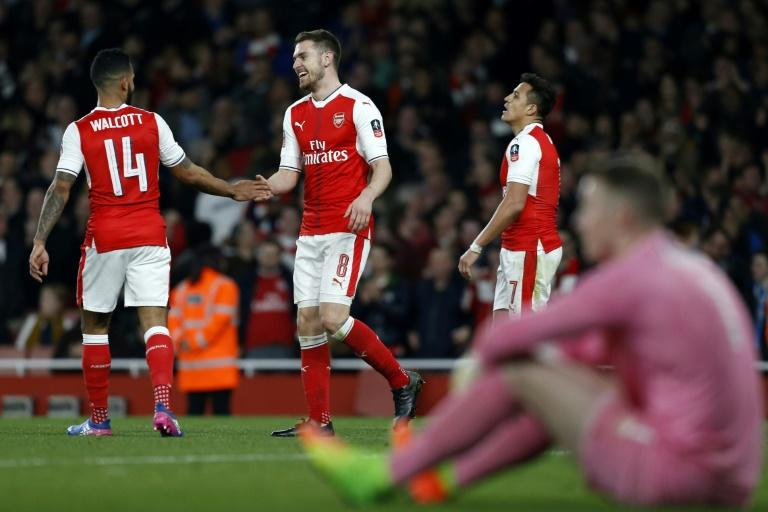 Arsenal's Aaron Ramsey (2nd L) celebrates with teammate Theo Walcott (L) after scoring their fifth goal against Lincoln City at The Emirates Stadium in London on March 11, 2017