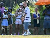 <p> Justin Bieber tees up while filming a <i>Happy Gilmore</i>-themed music video in Miami on Sunday. </p>