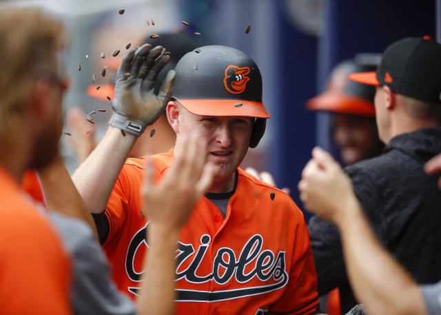 Baltimore Orioles designated hitter Mark Trumbo celebrates after hitting a grand slam in the first inning of a baseball game against the Atlanta Braves, Saturday, June 23, 2018, in Atlanta. (AP Photo/Todd Kirkland)