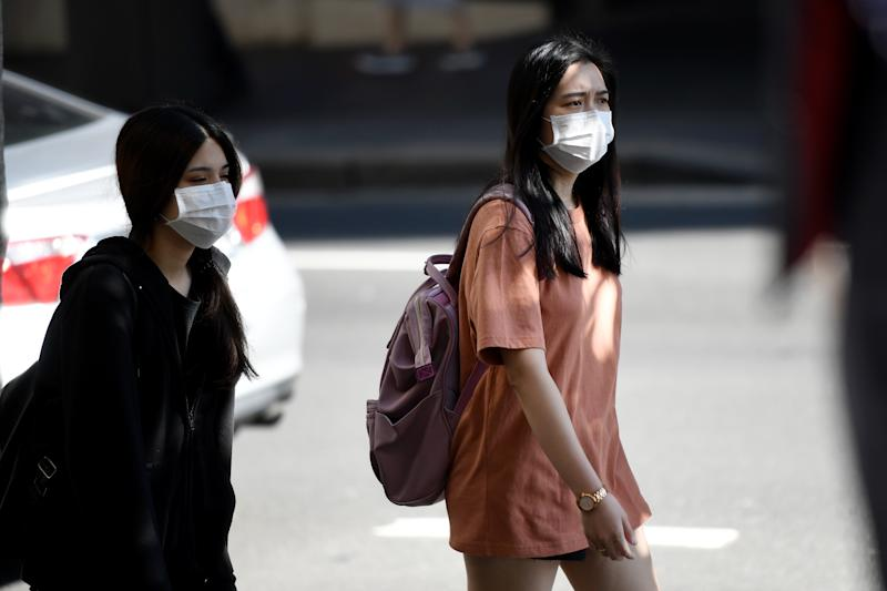 People are seen wearing face masks in Sydney on Tuesday. Source: AAP