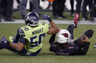 Arizona Cardinals quarterback Kyler Murray (1) is tackled by Seattle Seahawks outside linebacker K.J. Wright (50) during the first half of an NFL football game, Thursday, Nov. 19, 2020, in Seattle. (AP Photo/Elaine Thompson)