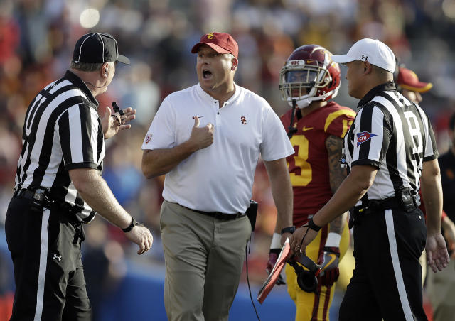 Southern California head coach Clay Helton, center, argues a call with a referee during the second half of an NCAA college football game against UCLA, Saturday, Nov. 17, 2018, in Pasadena, Calif. (AP)