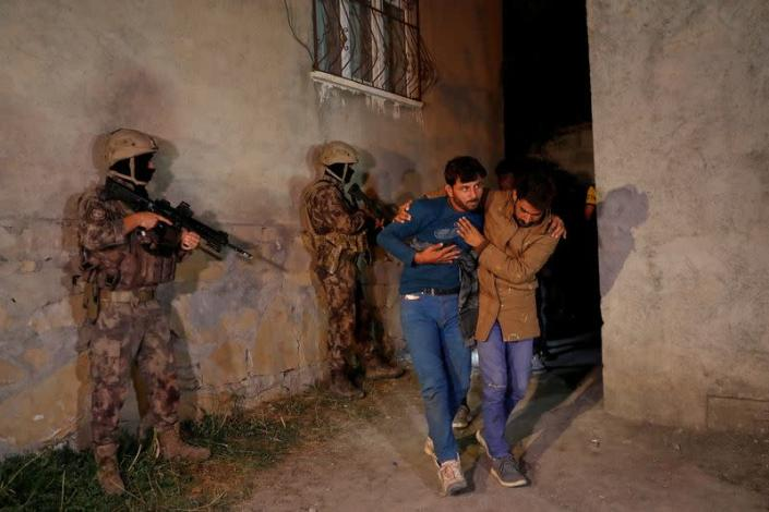 Migrants, mainly from Afghanistan, are seen after they were detained by Turkish security forces during an operation in the border city of Van
