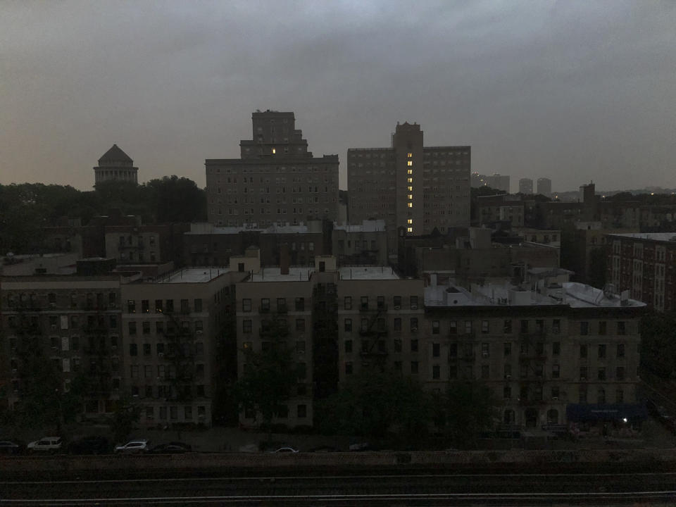 """Buildings in Harlem sit dark during a power outage early, Friday, Aug. 7, 2020, in New York. A power outage cast darkness across dozens of blocks in New York City as many people in the city were still without electricity in the aftermath of Tropical Storm Isaias. Con Edison said that a problem with its transmission system """"caused three networks in Manhattan to lose their electric supply,"""" just after 5 a.m. (AP Photo/Candice Choi)"""
