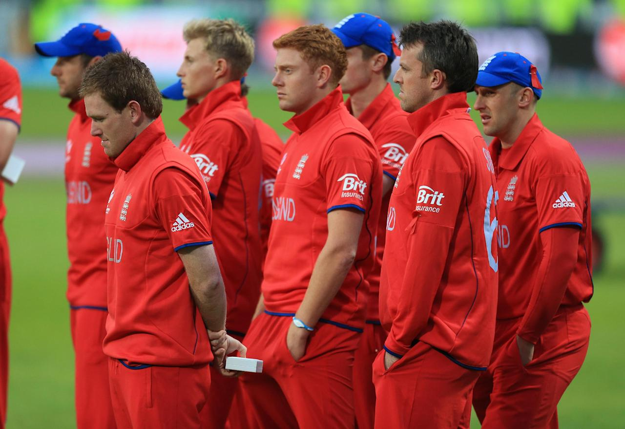 England players stand dejected after the ICC Champions Trophy Final at Edgbaston, Birmingham.
