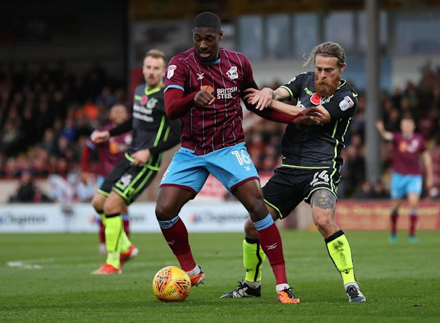 Soccer Football - League One - Scunthorpe United vs Bristol Rovers - Glanford Park, Scunthorpe, Britain - November 11, 2017 Scunthorpe United's Hakeeb Adelakun in action with Bristol Rovers' Stuart Sinclair Action Images/John Clifton