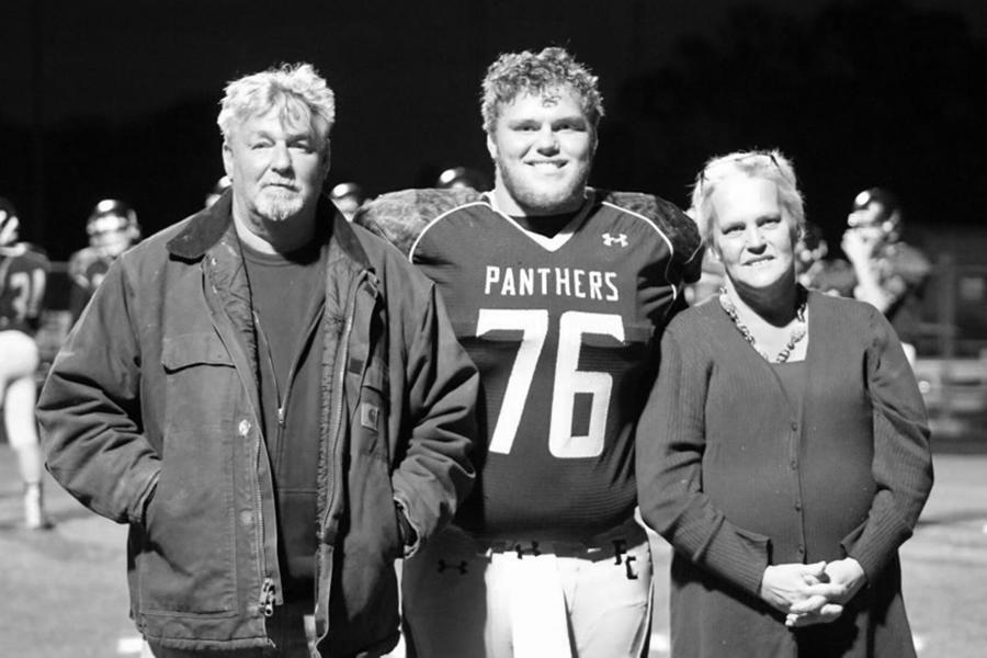 Image: Kim Johnson and her husband Delbert with their son Sam at a high school football game in November 2016. (Courtesy Kim Johnson)