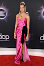 """<p>Hot pink was Dua Lipa's hue of choice for the <a href=""""https://www.cosmopolitan.com/uk/fashion/g29939695/american-music-awards-2019-red-carpet/"""" rel=""""nofollow noopener"""" target=""""_blank"""" data-ylk=""""slk:2019 American Music Awards"""" class=""""link rapid-noclick-resp"""">2019 American Music Awards</a>.</p>"""