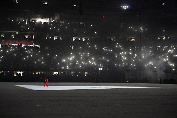Kanye West prowls the Mercedes-Benz Stadium floor during the 'Donda' listening event.
