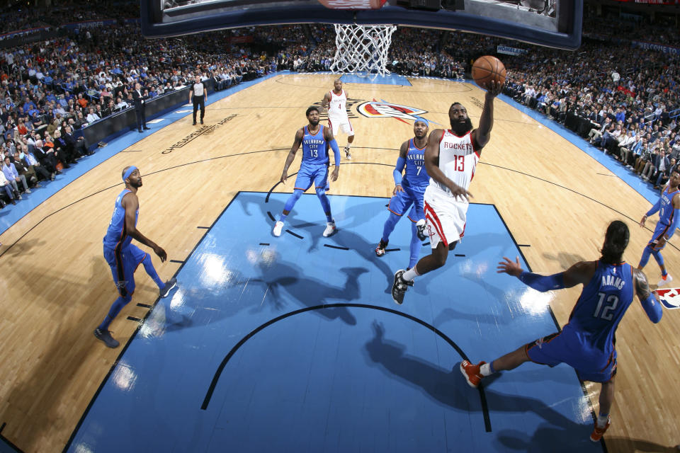 James Harden drives past Carmelo Anthony to the basket. (Getty)