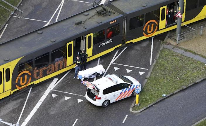 A body covered in a white sheet was seen near the tram after the shooting (AFP Photo/Ricardo Smit)