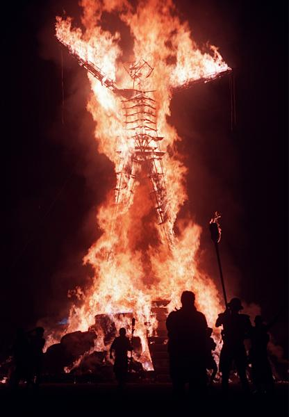 Hold for Story moving for Sunday AM's: In this file photo taken Sunday, Sept. 6, 1998, the 40-foot tall Burning Man is ignited to signal the end of the week-long Burning Man Festival held on the Black Rock Desert near Gerlach, Nv. It's never been so hard to be a hippie. A quarter century after the free spirits moved their party from San Francisco's Baker Beach to a dried up ancient lake bed 110 miles north of Reno, the Burning Man counterculture festival is faced with turning large numbers of its longtime participants away. With its drum circles and decorated art cars, guerilla theatrics and colorful theme camps, the annual pilgrimage to the playa in the name of both everything and nothing has become just too darn popular for its own good. (AP Photo/Reno Gazette Journal, Roger Duncan) NO SALES; MAGS OUT; NEVADA APPEAL OUT; SOUTH RENO WEEKLY OUT