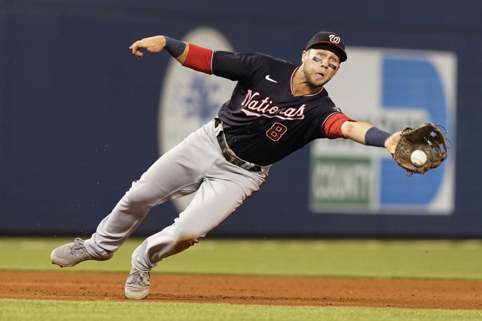 Washington Nationals shortstop Carter Kieboom (8) catches a ball hit by Miami Marlins' Lewis Brinson during the eight inning of a baseball game, Wednesday, Sept. 22, 2021, in Miami. (AP Photo/Marta Lavandier)
