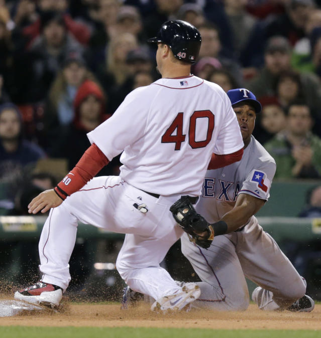 Texas Rangers third baseman Adrian Beltre can't make the tag in time as Boston Red Sox's A.J. Pierzynski (40) advances to third on a single by teammate Jackie Bradley Jr. during the second inning of a MLB baseball game at Fenway Park, Monday, April 7, 2014, in Boston.(AP Photo/Charles Krupa)