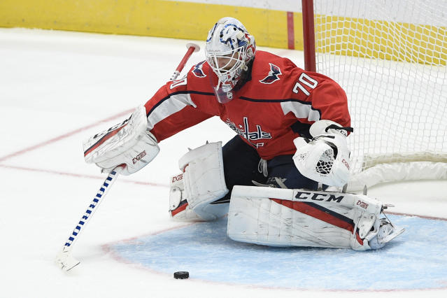 Washington Capitals goaltender Braden Holtby reaches for the puck during the third period of an NHL hockey game against the Vegas Golden Knights, Saturday, Nov. 9, 2019, in Washington. (AP Photo/Nick Wass)