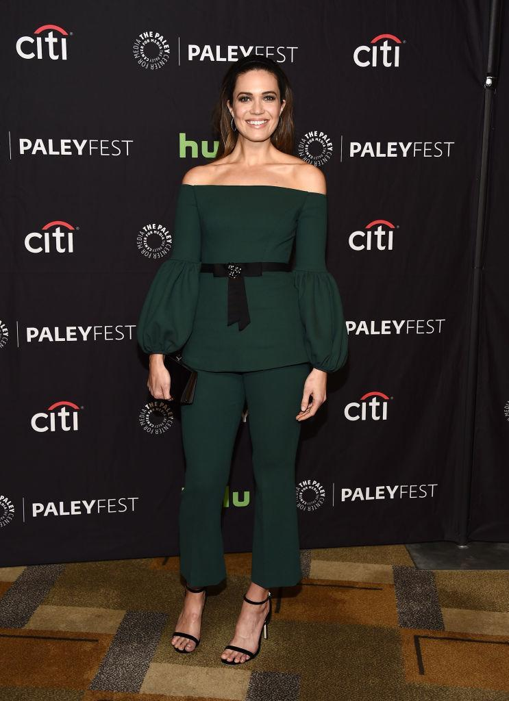 <p>Mandy moved away from girly into a more sophisticated look, choosing a gorgeous dark green suit.<br><i>[Photo: Getty]</i> </p>