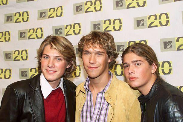 """<p>Founded in the early '90s, three squeaky-clean brothers made up the group Hanson. In 1996, they released their first version of <a href=""""https://www.amazon.com/Mmmbop/dp/B002AV0K7K/?tag=syn-yahoo-20&ascsubtag=%5Bartid%7C10063.g.35225069%5Bsrc%7Cyahoo-us"""" rel=""""nofollow noopener"""" target=""""_blank"""" data-ylk=""""slk:""""MMMBop,"""" class=""""link rapid-noclick-resp"""">""""MMMBop,</a>"""" which later became a huge hit when it was polished up and re-released on their 1997 hit album, """"Middle of Nowhere."""" The album sold 10 million copies worldwide.</p>"""