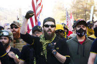 People identifying themselves as members of the Proud Boys join supporters of President Donald Trump as they march Saturday Nov. 14, 2020, in Washington. (AP Photo/Jacquelyn Martin)