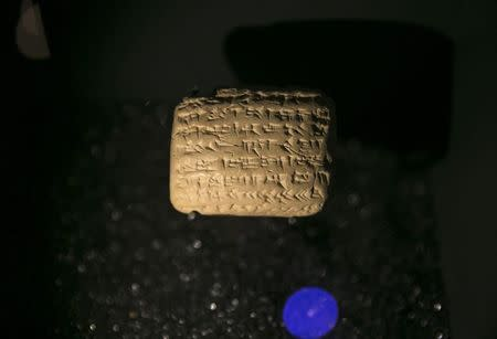 A cuneiform tablet is displayed during an exhibition at the Bible Lands Museum in Jerusalem, February 3, 2015. REUTERS/Baz Ratner