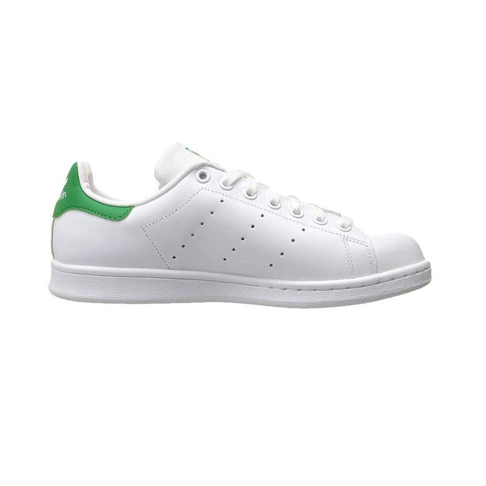 """<p><strong>ADIDAS</strong></p><p>amazon.com</p><p><strong>$49.99</strong></p><p><a href=""""https://www.amazon.com/adidas-Originals-Fashion-Sneakers-Fairway/dp/B00R6BWL30/?tag=syn-yahoo-20&ascsubtag=%5Bartid%7C10065.g.36791500%5Bsrc%7Cyahoo-us"""" rel=""""nofollow noopener"""" target=""""_blank"""" data-ylk=""""slk:Shop Now"""" class=""""link rapid-noclick-resp"""">Shop Now</a></p><p>White leather sneakers have defined the past decade in fashion and aren't going anywhere anytime soon. If your wardrobe needs a new pair, Stan Smiths are as classic as they come. Peep <a href=""""https://www.harpersbazaar.com/fashion/a33623581/adidas-stan-smiths-super-sale/"""" rel=""""nofollow noopener"""" target=""""_blank"""" data-ylk=""""slk:Phoebe Philo"""" class=""""link rapid-noclick-resp"""">Phoebe Philo</a> wearing hers with a cozy turtleneck and black jeans for style inspo. </p>"""