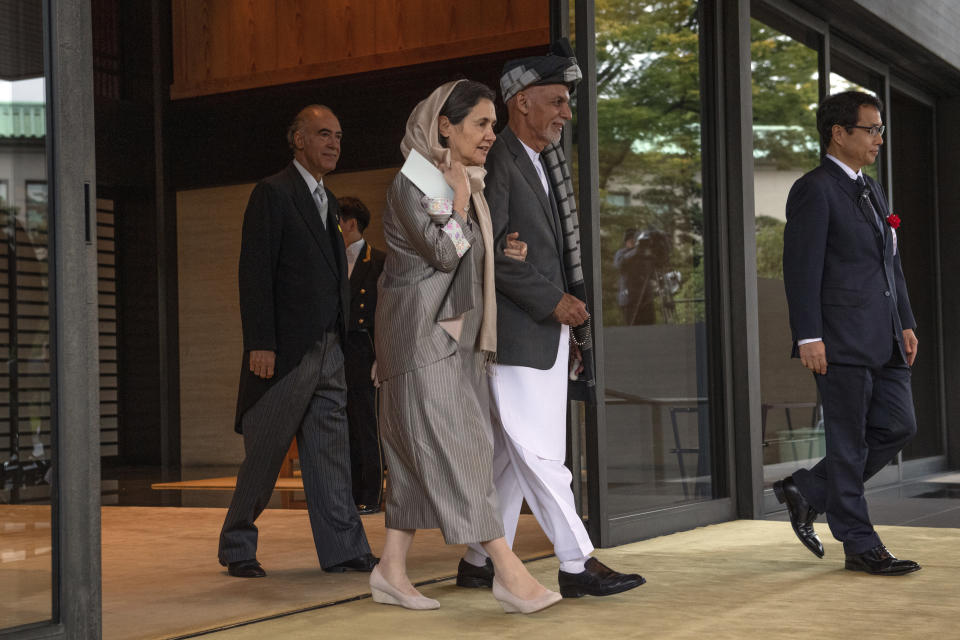 President of Afghanistan, Ashraf Ghani, and his wife Rula Ghani leave after attending the Enthronement Ceremony Of Emperor Naruhito of Japan at the Imperial Palace, Tuesday, Oct. 22, 2019, in Tokyo. (Carl Court/Pool Photo via AP)