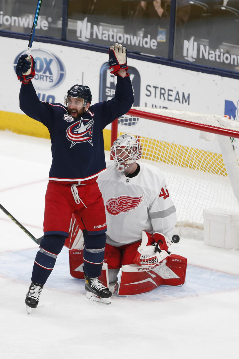 Columbus Blue Jackets' Nick Foligno, left, celebrates their goal against Detroit Red Wings' Jonathan Bernier during the second period of an NHL hockey game Tuesday, March 2, 2021, in Columbus, Ohio. (AP Photo/Jay LaPrete)