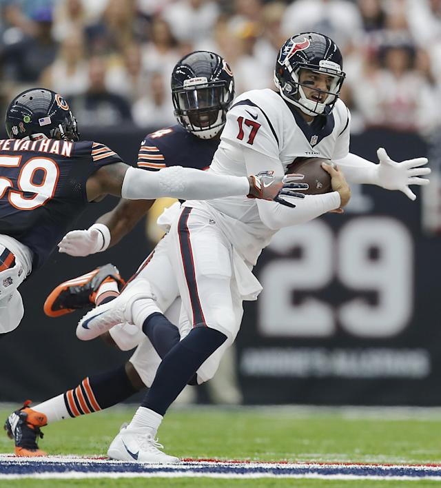 <p>Brock Osweiler #17 of the Houston Texans breaks the tackle of Danny Trevathan #59 of the Chicago Bears in the first quarter at NRG Stadium on September 11, 2016 in Houston, Texas. (Photo by Thomas B. Shea/Getty Images) </p>