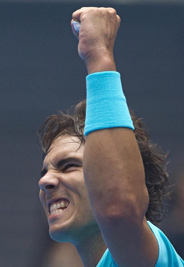 Rafael Nadal of Spain celebrates after defeating Fabio Fognini of Italy during the quarterfinal match of the China Open tennis tournament at the National Tennis Stadium in Beijing, China Friday, Oct. 4, 2013. (AP Photo/Andy Wong)