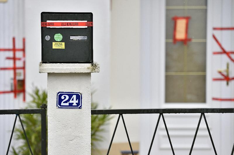 Police sealed displayed on the mail box and the entrance of the house of the Troadec family, the day after the brother in law of the father, Hubert Caouissin confessed the killing of all four members of the family