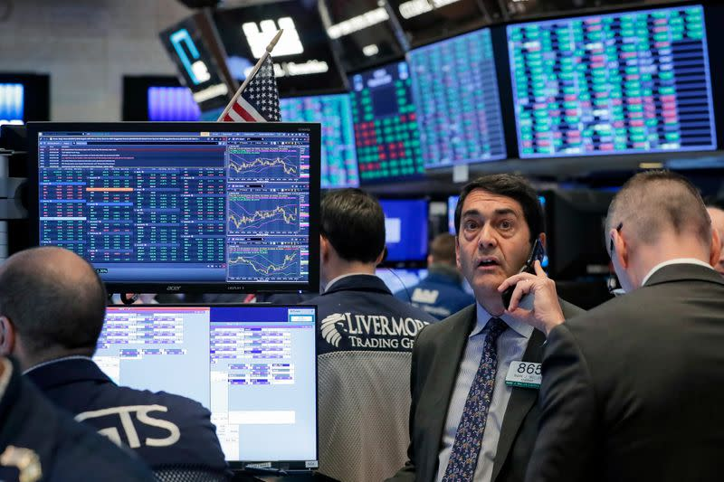Stocks down on virus' economic toll; dollar falls further