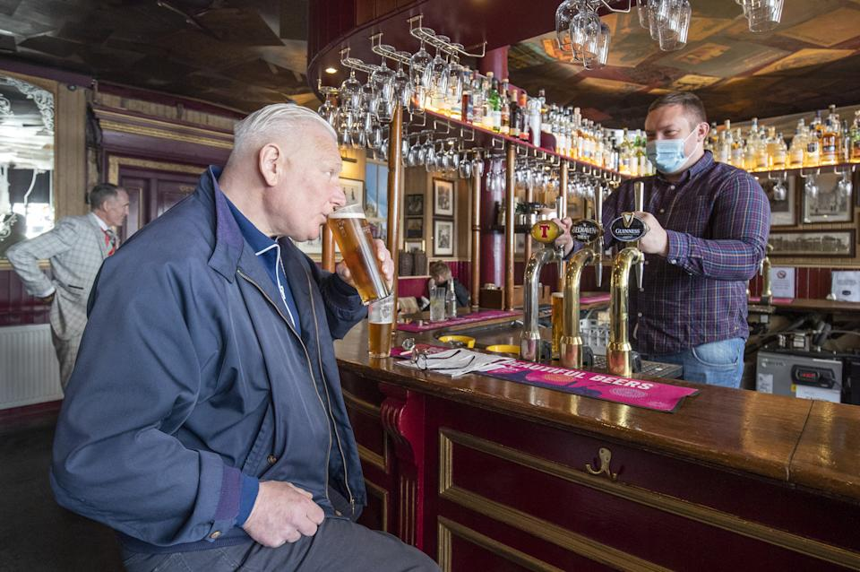 Customers in the Waverley, Edinburgh, enjoy a drink inside the bar. Alcohol can now be served inside pubs and restaurants, which are allowed to stay open until 22.30, as Scotland moves to Level 2 restrictions to ease out of lockdown.
