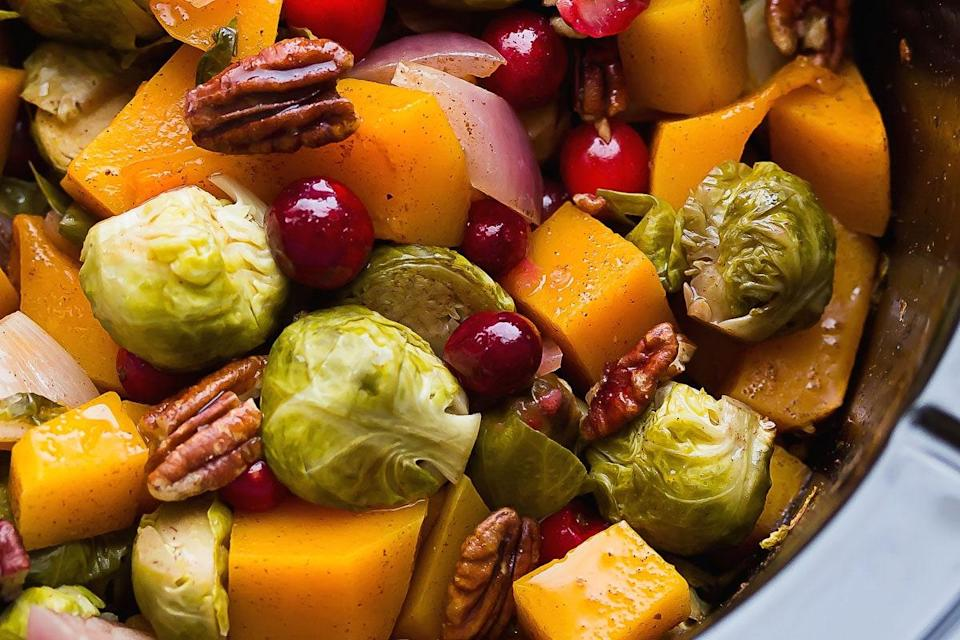 """This dish has major <a href=""""https://www.epicurious.com/holidays-events/easiest-thanksgiving-recipes-gallery?mbid=synd_yahoo_rss"""" rel=""""nofollow noopener"""" target=""""_blank"""" data-ylk=""""slk:Thanksgiving"""" class=""""link rapid-noclick-resp"""">Thanksgiving</a> vibes, but we plan on serving it throughout the fall. It's that good. <a href=""""https://www.epicurious.com/recipes/food/views/slow-cooker-brussels-sprouts-with-cranberries-pecans-and-butternut-squash?mbid=synd_yahoo_rss"""" rel=""""nofollow noopener"""" target=""""_blank"""" data-ylk=""""slk:See recipe."""" class=""""link rapid-noclick-resp"""">See recipe.</a>"""
