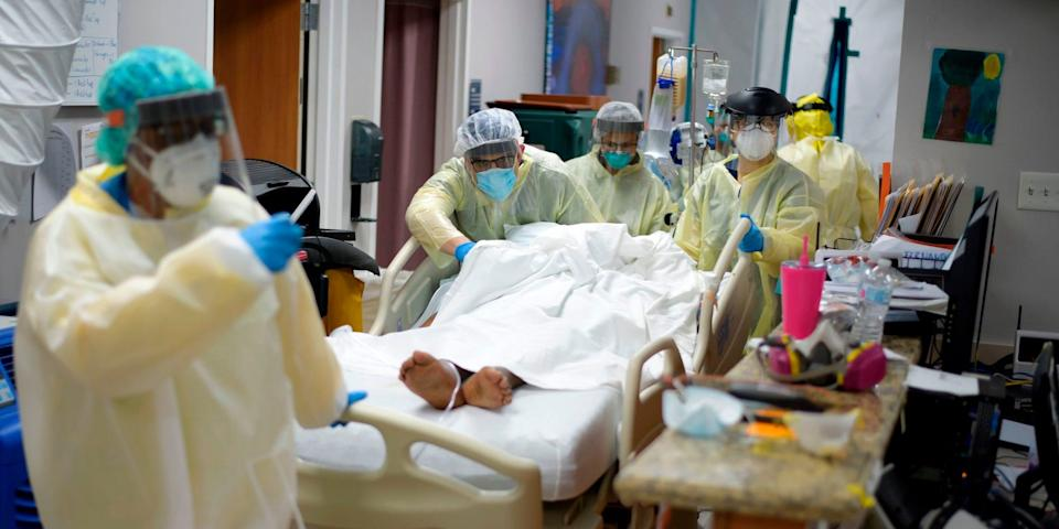 Healthcare workers move a patient in the Covid-19 Unit at United Memorial Medical Center in Houston, Texas Thursday, July 2, 2020.