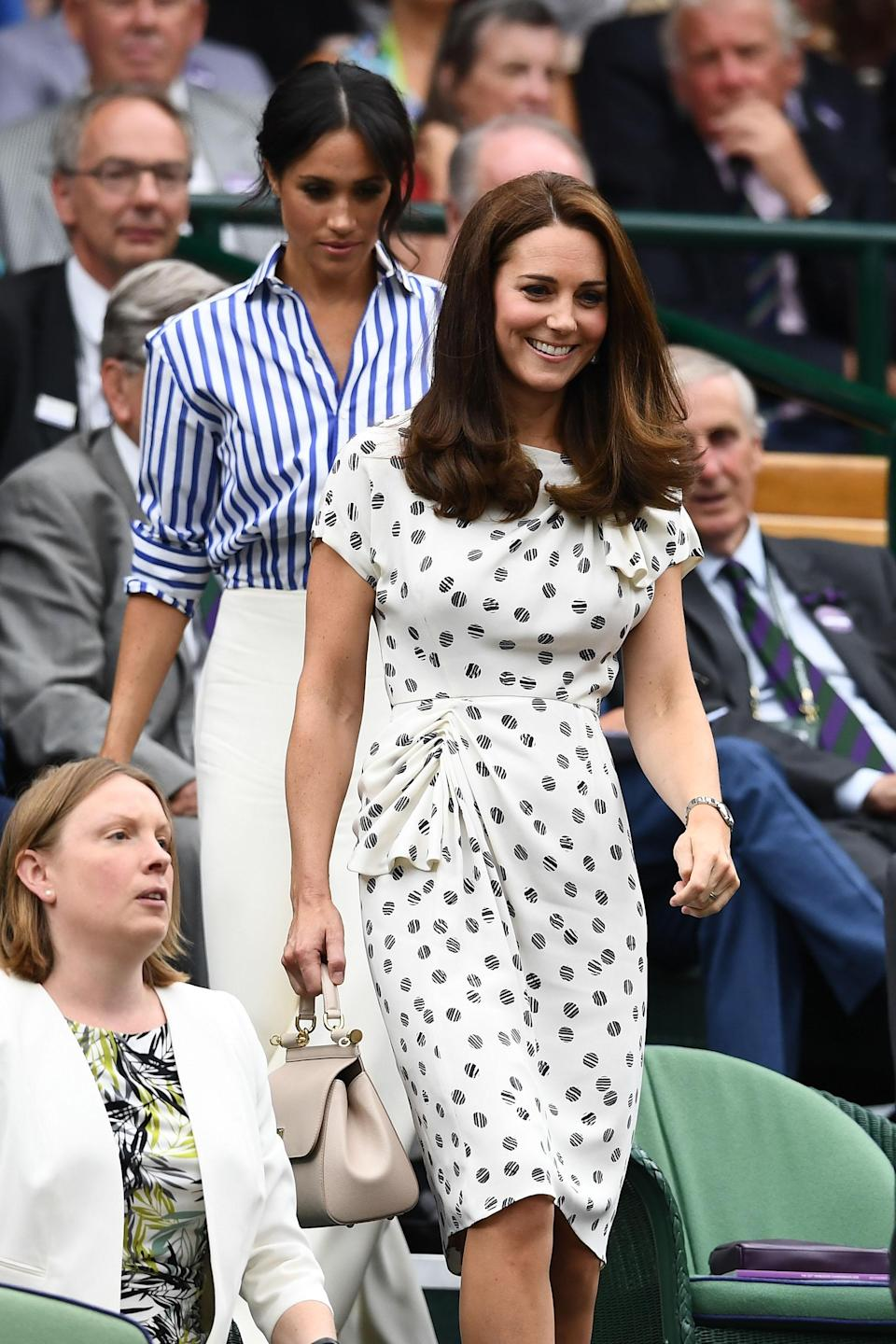 <p>The Duchess of Cambridge joined her new sister-in-law for day 12 of Wimbledon in a Jenny Packham midi dress accessorised with a Dolce and Gabbana handbag. <em>[Photo: Getty]</em> </p>