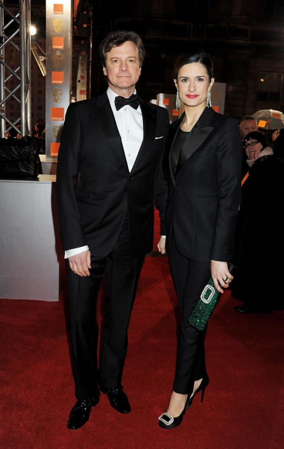 Livia Firth with Colin Firth on the red carpet. She leveraged the global attention at awards events to provide as a platform to talk about environmental and social justice(Getty Images)