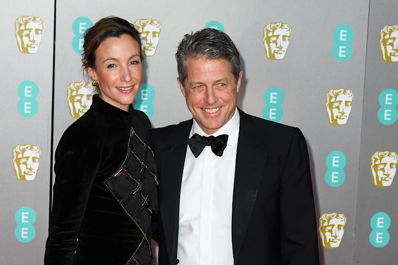 Anna Eberstein and Hugh Grant attend the EE British Academy Film Awards 2020 at Royal Albert Hall on February 02, 2020 in London, England. (Photo by Stephane Cardinale - Corbis/Corbis via Getty Images)