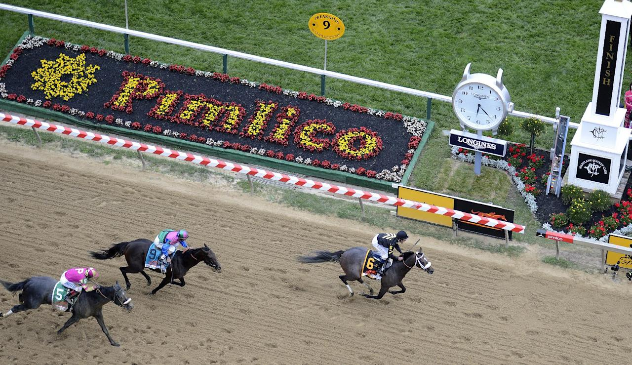 Oxbow (6), ridden by jockey Gary Stevens, wins the 138th Preakness Stakes horse race ahead of Itsmyluckyday (9), ridden by John Velazquez, and Mylute, ridden by Rosie Napravnik at Pimlico Race Course, Saturday, May 18, 2013, in Baltimore. (AP Photo/Nick Wass)
